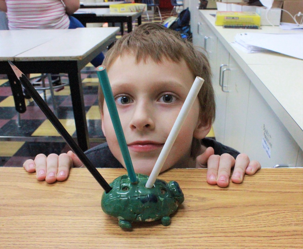 After-School Program: testing his adorable turtle pen holder (clay)